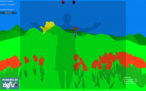 Screen capture from one of the playscapes of Sow/Reap. The image depicts a cartoon field with a shadow of a human whose arms are open wide. The shadow of the human is flanked on both sides by red poppies.